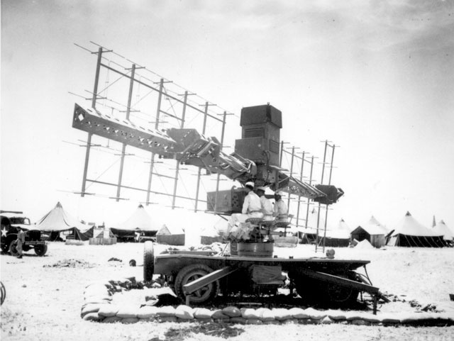 Three soldiers of the United States Army sit in place at a radar used by the 90th Coast Artillery in Casablanca, French Morocco. June 19, 1943. 111-SC-223413