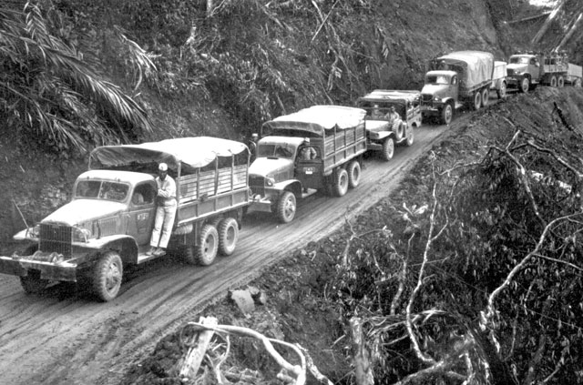U.S.-built Army trucks wind along the side of the mountain over the Ledo supply road now open from India into Burma  n.d. 208-AA-45L-1