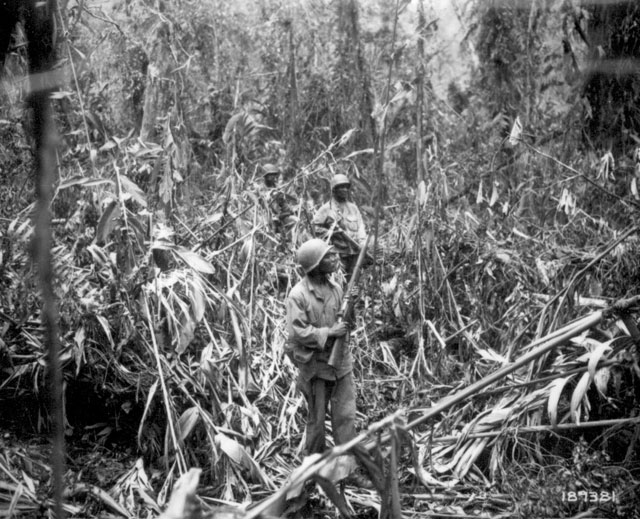 Cautiously advancing through the jungle, while on patrol in Japanese territory off the Numa-Numa Trail, this member of the 93rd Infantry Division is among the first Negro foot soldiers to go into action in the South Pacific theater. May 1, 1944. 111-SC-189381-S