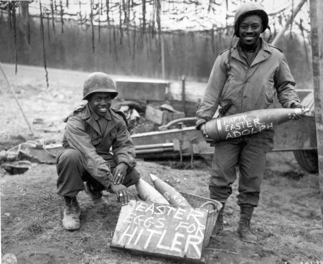 Easter morning, T/5 William E. Thomas and Pfc. Joseph Jackson will roll specially prepared eggs on Hitler's lawn. March 10, 1945. 1st Lt. John D. Moore. 111-SC-202330.