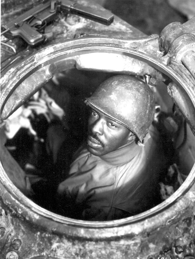 Cpl. Carlton Chapman is a machine-gunner in an M-4 tank, attached to a Motor Transport unit near Nancy, France. 761st Mt. Bn. November 5, 1944. Ryan. 111-SC-196106-S.