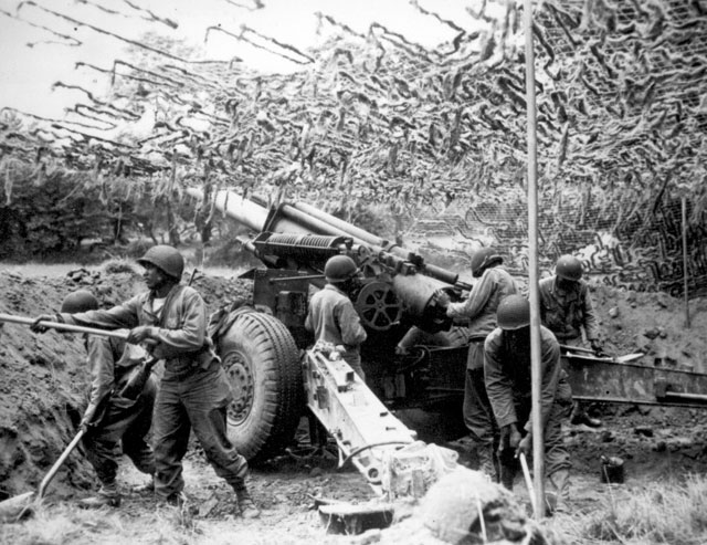 Troops of a field artillery battery emplace a 155mm howitzer in France. They have been following the advance of the infantry and are now setting up this new position. June 28, 1944. Rothenberger. 111-SC-191890-S.