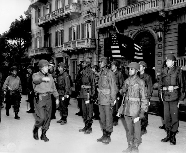 Maj. Gen. Edward M. Almond, Commanding General of the 92nd Infantry ('Buffalo') Division in Italy, inspects his troops during a decoration ceremony. Ca. March 1945. 208-AA-47Y-1.