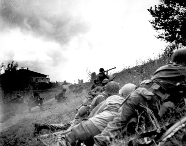 This Negro combat patrol advanced three miles north of Lucca (furthermost point occupied by American troops)  to contact an enemy machine gun nest. Here a bazooka-man cuts loose at the target some 300 yards distant.  September 7, 1944. Edwards. 111-SC-194328.