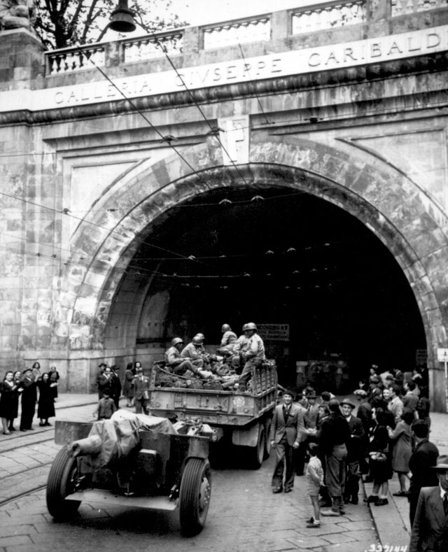Genoa, Italy. In this newly liberated city the 92nd Division troops enter the Galleria Guiseppe [sic] Garibaldi.  April 27, 1945. Leviton. 111-SC-337144.