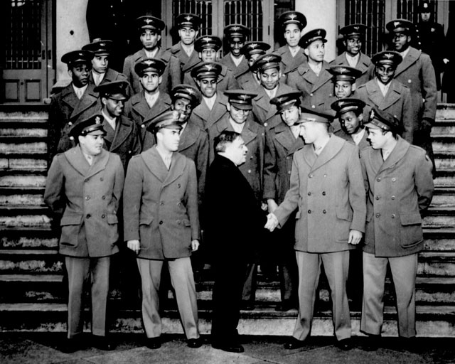 Members of the Nation's first Negro Navigation Cadets, who will receive their commissions in the Army Air Forces on February 26th, visited City Hall as guests of Mayor Fiorello H. La Guardia this afternoon. They are shown on the steps of City Hall as the mayor greeted their commanding officer, Maj. Galen B. Price. February 16, 1944. Acme. 208-PU-113M-26.