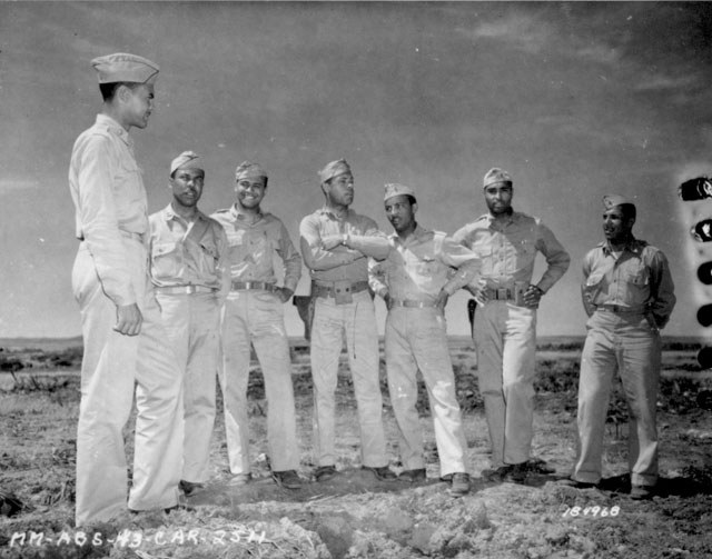 Staff officers of an Air Corp Squadron near Fez, French Morocco. Left to right: Lt. Col. Benjamin O. Davis, C.O.; Capt. Hayden C. Johnson, Adjutant; Capt. E. Jones, Service Det.; Lt. Wm. R. Thompson, Armaments; Lt. Hervert E. Carter, Engineers; Lt. Erwin B. Lawrence, Operations; Lt. George R. Currie, Ordnance. May 12, 1943. 111-SC-184968.