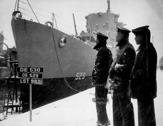 Negro sailors of the U.S.S. Mason (DE 529) commissioned at Boston Navy Yard on 20 Mar. 1944 proudly look over their ship which is the first to have [a] predominately Negro crew. March 20, 1944. 80-G-218861.