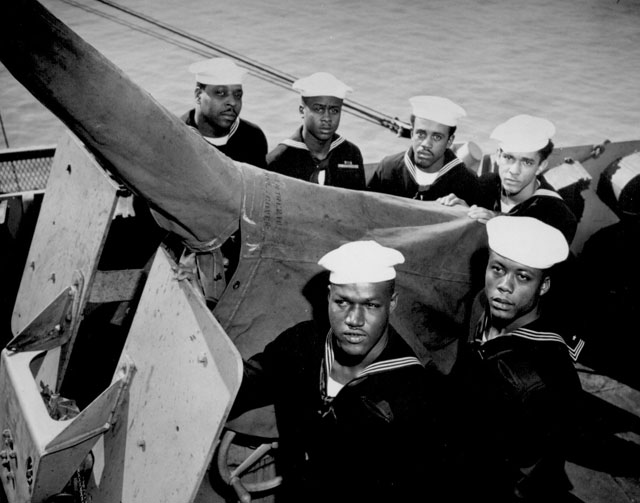 A gun crew of six Negroes who were given the Navy Cross for standing by their gun when their ship was damaged by enemy attack in the Philippine area. Crew members: Jonell Copeland, AtM2/c; Que Gant, StM; Harold Clark, Jr., StM; James Eddie Dockery, StM; Alonzo Alexander Swann, StM; and Eli Benjamin, StM. Ca. 1945. 80-G-334029
