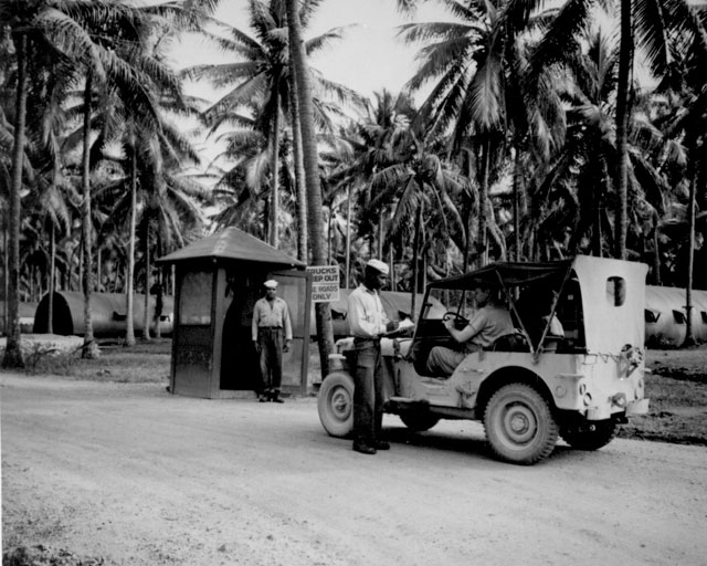 Entrance to the U.S. Navy Base Camp Annex, Espiritu Santo, New Hebrides. Guards on duty: S1/c Dook Bland and S1/c Taft Gray. N.d. 80-G-123962.