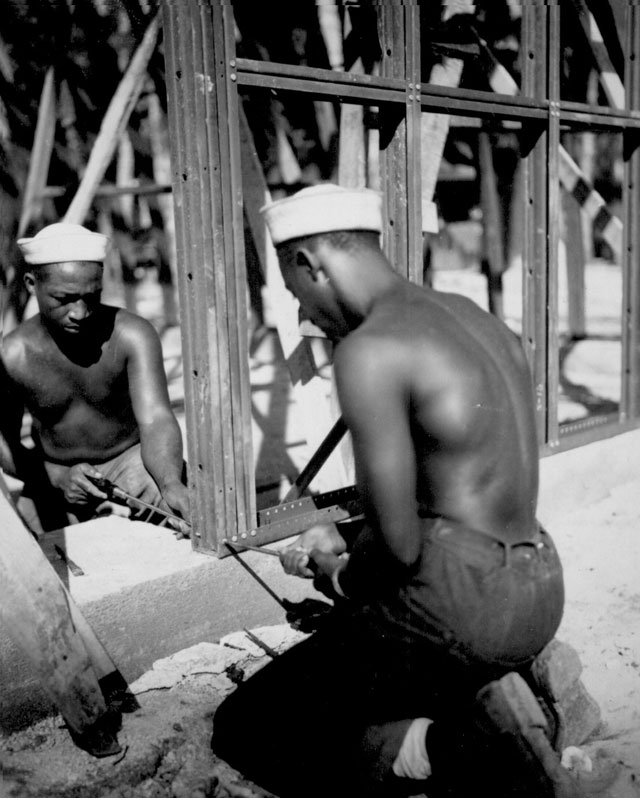 Construction of the prefabricated steel storage warehouse [by members of the 34th Construction Bn.] at Halavo Seaplane Base, Florida Island [Solomon Islands]. September 19, 1943. 80-G-89138
