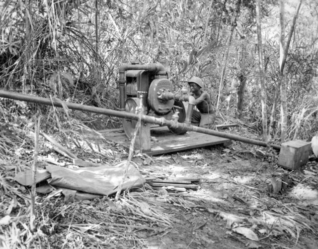 34th CBs working on purification of their water supply at Solomon Islands. Ca. August 1945. 80-G-203393.