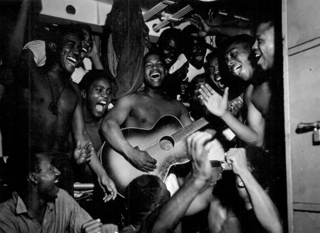 Enlisted men aboard the U.S.S. Ticonderoga (CV-14) hear the news of Japan's surrender. August 14, 1945. Lt. B. Gallagher. 80-G-469544.