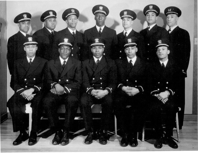 Group of recently appointed Negro officers. Left to right, front row: Ensigns George Clinton Cooper, Graham Edward Martin, Jesse Walter Arbor, John Walter Reagan, Reginald Ernest Goodwin. Back row, left to right, Ensigns Phillip George Barnes, Samuel Edward Barnes, Dalton Louis Baugh, James Edward Hare, Frank Ellis Sublett, and WO Charles Byrd Lear. February 1944. 80-G-300215.