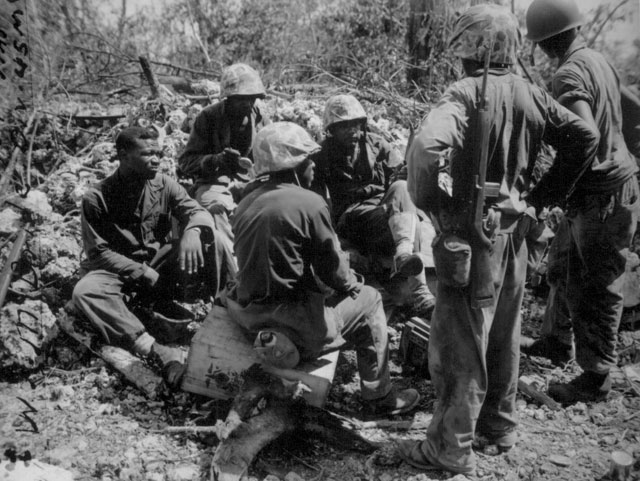Group of CBs acting as stretcher bearers for the 7th Marines. Peleliu. September 1944. Sgt. McBride. 127-N-96475.