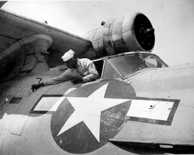 Negro mechanics work on PBY at NAS Seattle, WA, Alvin V. Morrison, AMM 3/c, doing overhaul. April 27, 1944. 80-G-233274.