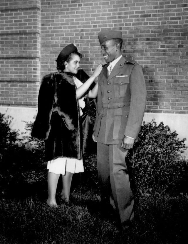 The first Negro to be commissioned in the Marine Corps has his second lieutenant's bars pinned on by his wife. He is Frederick C. Branch of Charlotte, NC. November 1945. 127-N-500043.