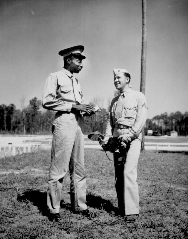 Handling Negro Marine public relations at the Montford Point Camp here are Sgt. Lucious A. Wilson (left), and his photographer, Cpl. Edwin K. Anderson. Sgt. Wilson is a former correspondent for the New York Amsterdam News. d. 208-NP-10FFFF-1.