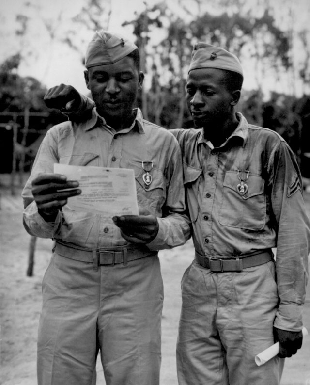First Negro Marines decorated by the famed Second Marine Division somewhere in the Pacific (left to right) Staff Sgt Timerlate Kirven and Cpl. Samuel J. Love, Sr. They received Purple Hearts for wounds received in the Battle of Saipan. N.d. 208-NP-10SSSS-1.
