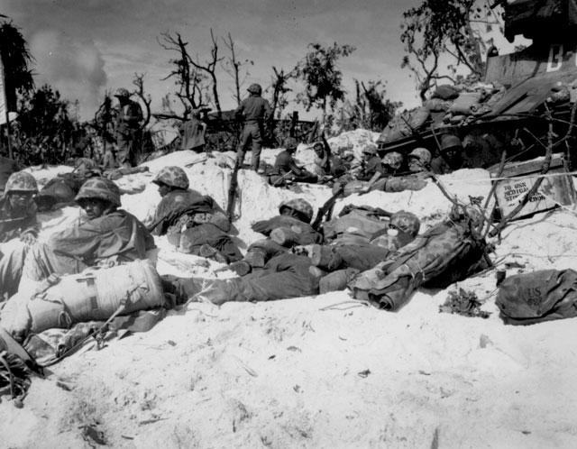 Peleliu Island Marines move through the trenches on the beach during the battle. September 15, 1944. Fitzgerald. 127-N-9527.