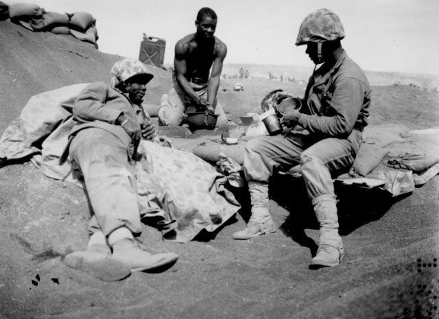 Iwo Jima Negro Marines on the beach at Iwo Jima are, from left to right, Pfcs. Willie J. Kanody, Elif Hill, and John Alexander. March 1945. C. Jones. 127-N-11383