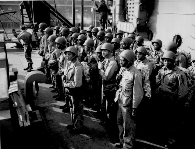 Aboard a Coast Guard-manned transport somewhere in the Pacific, these Negro Marines prepare to face the fire of Jap[anese] gunners. Ca. February 1944. 26-G-321.