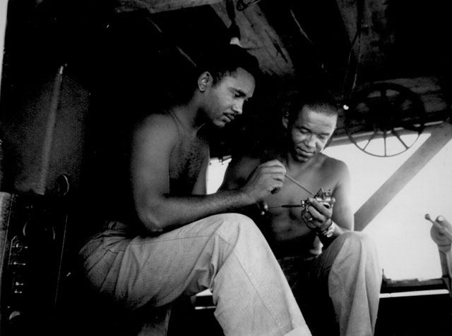 Two Negro Marine movie operators. January 1945. 127-N-109561.