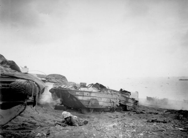 Two Negro duck [DUKW] drivers turn riflemen after their vehicle is destroyed. February 19, 1945. Christian. 127-N-111123