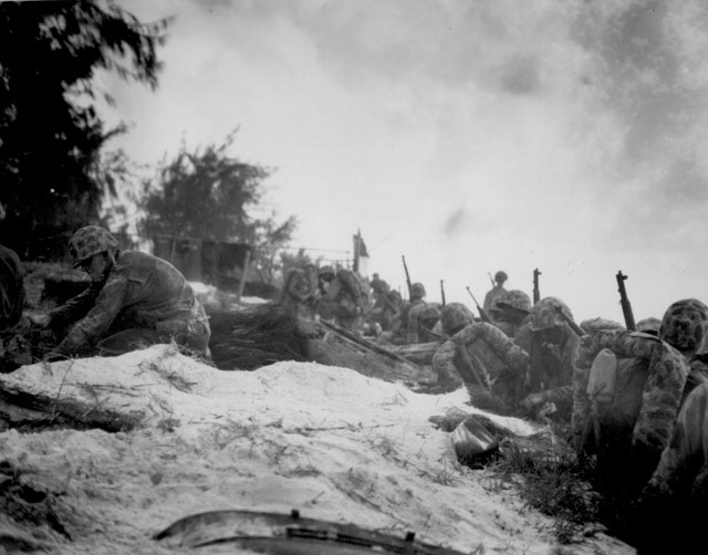 Negro assault troops await orders D-day to attack enemy shortly after they had come ashore at Saipan in the Marianas. June 1944. T/Sgt. William Fitch. U.S. Coast Guard, 127-N-83928.