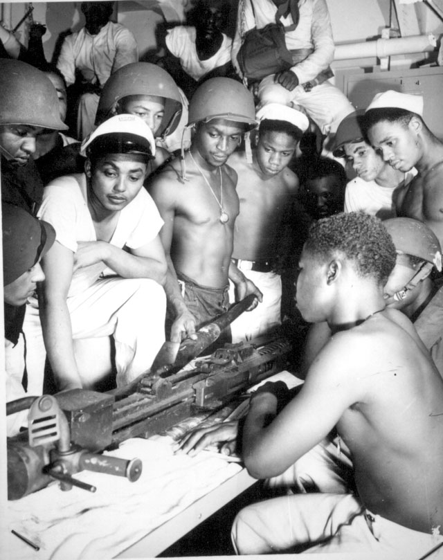 Crew members who man the 20mm guns of a Coast Guard fighting ship have won an enviable reputation for gunnery results, due primarily to incessant practice in assembly and operation. As expressed by the intent faces in this picture, these men play for keeps. N.d. 26-G-3154.
