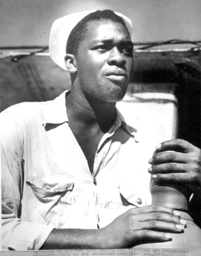 Coast Guardsman Marvin Sanders, Fireman first class, is presently serving in the engine room of a Coast Guard manned Army repair ship doing a vital job repairing the invading fleet in the southwest Pacific. N.d. 208-NP-8WWW-8.