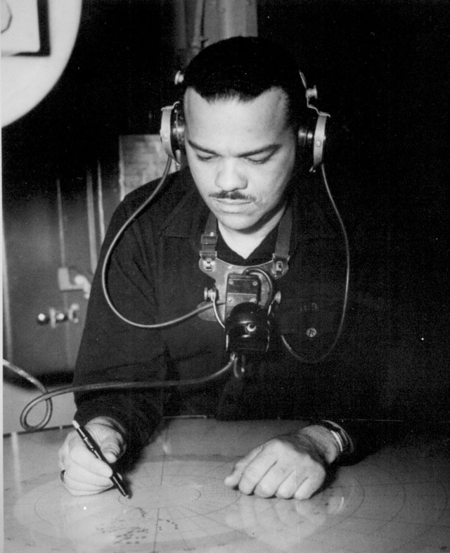 Coast Guardsman Joseph K. Noel, Radioman third class, is pictured on duty aboard a Coast Guard-manned frigate doing patrol duties in the North Pacific. N.d. 208-NP-8VVV-5.