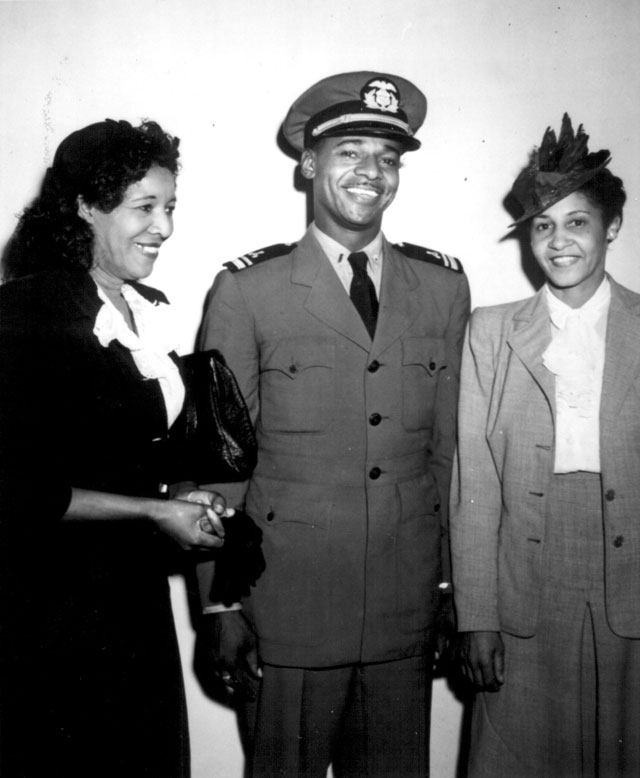 Lt.(jg.) Stanly Marlowe Smith, U.S. Maritime Service; [Mrs. Marion H. Elliott] Assistant Executive Secretary of the National Council of Negro Women; and Mrs. B.L. Derrick, Chairman. Lt. Smith is pictured at a war bond rally in Washington, DC, where he spoke and was honored. August 8, 1944. 357-G-83-4308.