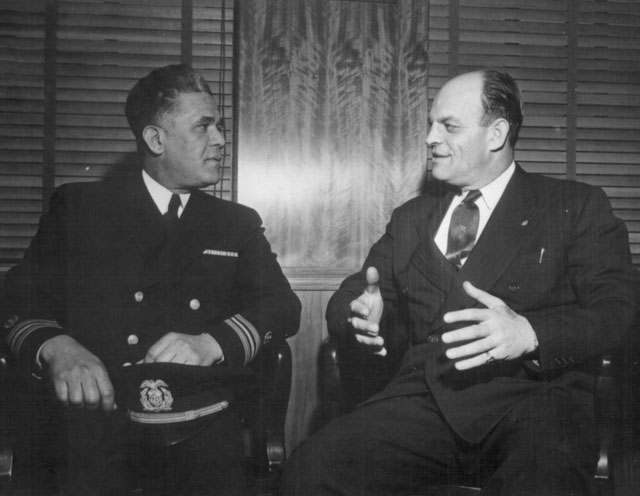 Capt. Clifton Lastic, Master of Liberty Ship [SS] Bert Williams chats with Joe Curran, President of N.M.U. [National Maritime Union]. The SS Bert Williams is named for an African-American comedian. N.d. 357-G-86-510.