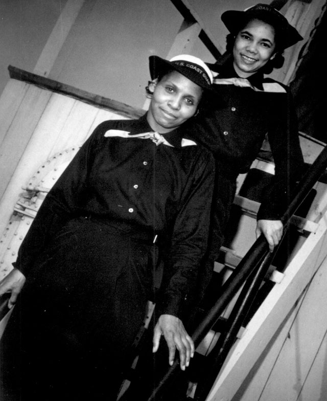 Two Negro SPARS pause on the ladder of the dry-land ship 'U.S.S. Neversail' during their 'boot' training at the  U.S. Coast Guard Training Station, Manhattan Beach, Brooklyn, NY. They are recent enlistees and have the  ratings of apprentice seamen. In front is SPAR Olivia Hooker  and behind her is SPAR Aileen Anita Cooks. N.d. 208-NP-10K-1.