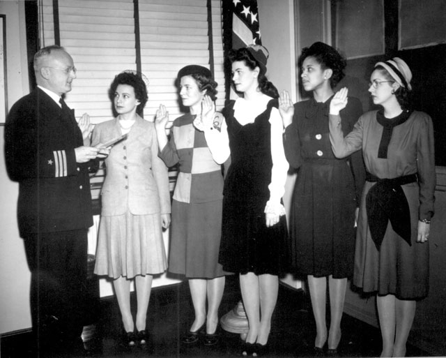 Cmdr. Thomas A. Gaylord, USN (Ret'd), administers oath to five new Navy nurses commissioned in New York  Phyllis Mae Dailey, the Navy's first African-American nurse, is second from the right.  March 8, 1945. 80-G-48365.