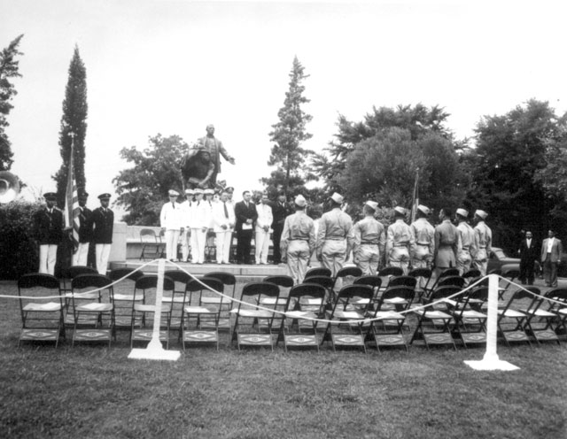 Address of welcome to [Army Air Corps] cadets in front of Booker T. Washington Monument on the grounds of Tuskegee Institute. Tuskegee, AL. August 1941. 111-SC-122432.