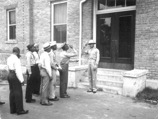 [Army Air Corps] cadets reporting to Captain B[enjamin] O. Davis, Jr. commandant of cadets. Tuskegee Field, AL. September 1941. 111-SC-122434.