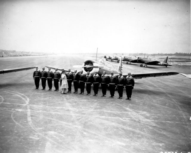 Officer returns salute as he passes the cadets lined up during review. Tuskegee Field, AL. N.d. 208-NP-5QQ-6.