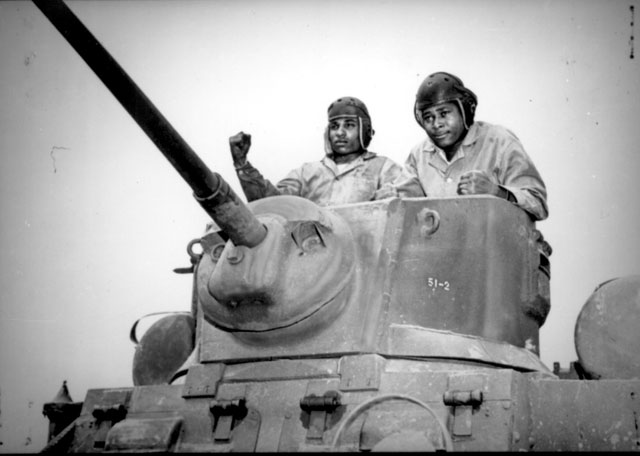 Two recruits in a light tank during training in mechanized warfare at Montford Point Camp, NC. April 1943. Pat Terry. 127-N-5320-B.