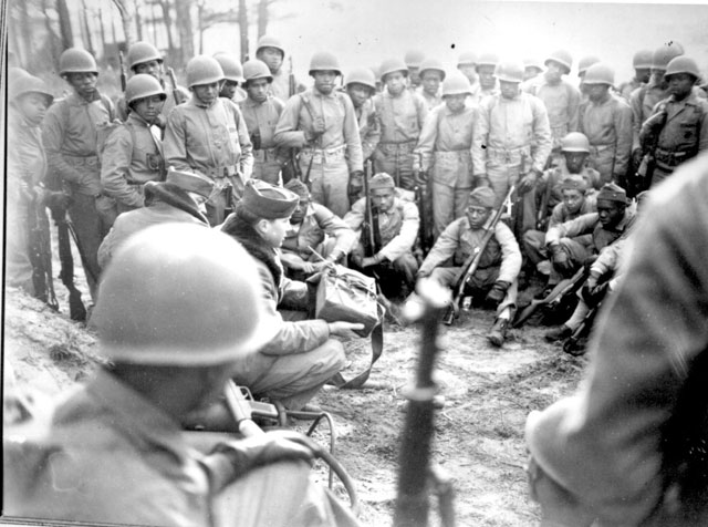 Marines receiving instruction in the Demolition Course at Montford Point Camp [NC], during intensive combat training in preparation for action in the Pacific. February 1945. Sgt. L. A. Wilson. 127-N-9019.