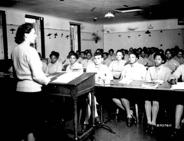 U.S. Army nurses are taking notes during a lecture in [a] classroom at the Army Nurse Training Center in England. September 5, 1944. Klosterman. 111-SC-37076.