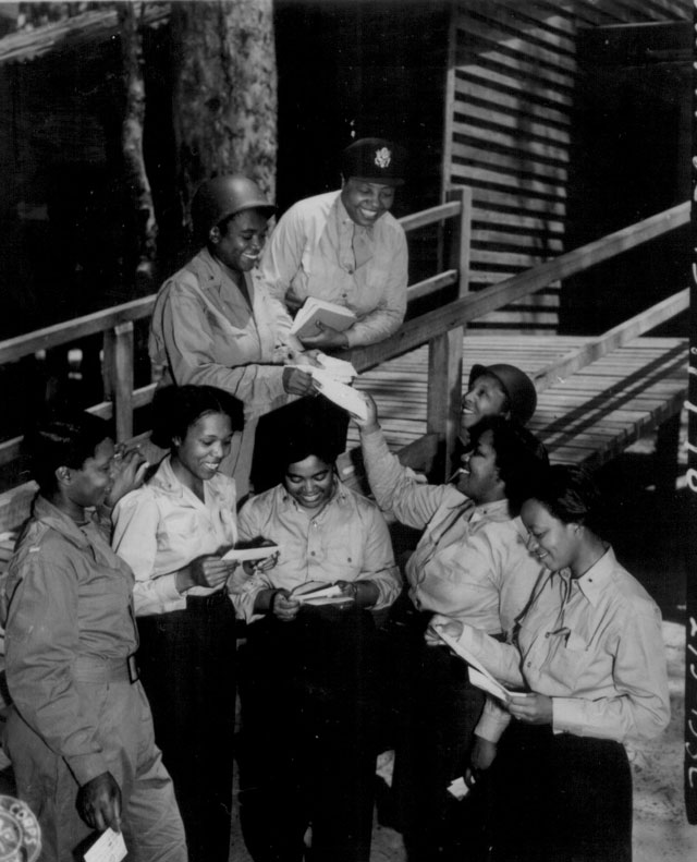 A contingent of 15 nurses, arrive in the southwest Pacific area, received their first batch of home mail at their station. 268th Station Hospital, Australia. Three of the nurses are Lts. Prudence L. Burns, Inez Holmes, and Birdie E. Brown. November 29, 1943. Sgt. Dick D. Williams. 111-SC-370740.