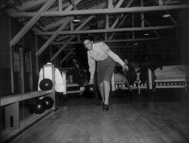 The Bowling Alleys at Fort McClellan, Alabama, are well patronized by members of WAC Det #2 in their off-duty hours. M/Sgt Helen Starr is ready to send a ball on its way down the alley. January 27, 1944. 111-SC-18369.