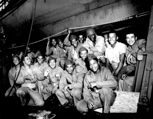 Aboard a U.S. Coast Guard-manned transport somewhere in the Pacific, a group of Negro Marines presents a cheerful front. N.d. 26-G-322.
