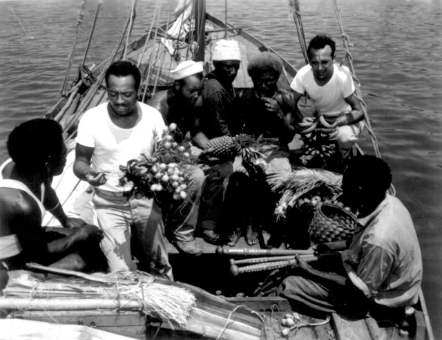 34th CB's trading with natives from Malaita. Left to right: native; Percy J. Hope, MS2c; Lilton T. Walker, S1c; two natives; Jack Kelsen, SC1c. Halavo, Florida Island, Solomon Islands. September 23, 1943. 80-G-8916.