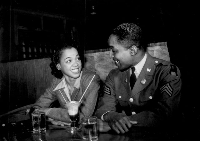 Sgt. Franklin Williams, home on leave from army duty, with his best girl Ellen Hardin, splitting a soda. They met at Douglas High School. Baltimore, MD. May 1942. Arthur Rothstein. 208-NP-6LL-11.