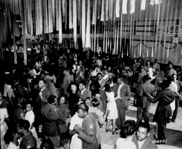 Christmas Dance at Negro Service Club #3. The dance was sponsored by the 1323rd Engineers. They had their  own orchestra. Camp Swift, Texas. December 23, 1943. Pvt. Greene.  111-SC-188341.