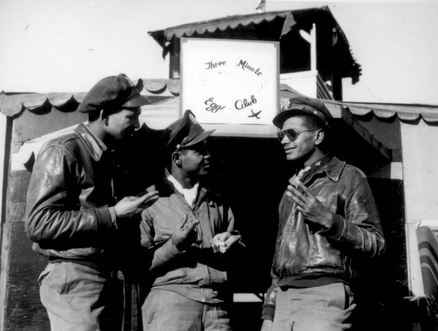 Long, dangerous missions over enemy territory and inclement weather often necessitate fighter planes returning to their bases with gas in their tanks for little over 3 minutes flying time. Pilots of a 15th AAF squadron decided to form a club to be known as 'The Three Minute Egg Club', with membership limited to those  unfortunates who landed within the narrow margin. Left to right: 1st Lts. Clarence A. Dart and Wilson D. Eagelson and 2d Lt. William N. Olsbrook. N.d. 208-AA-47E-1.