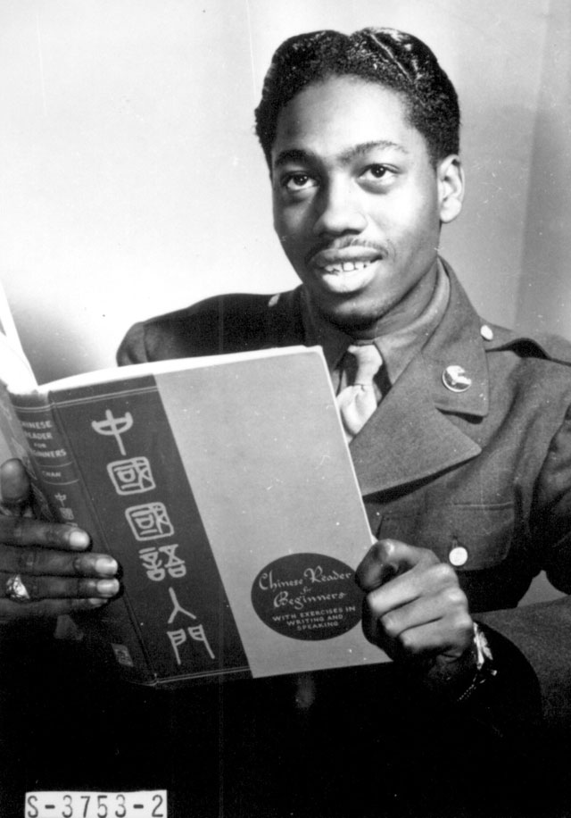 Pvt. Lloyd A. Taylor, 21-year-old transportation dispatcher at Mitchel Field, New York City, who knows Latin, Greek, Spanish, French, German, and Japanese, studies a book on Chinese. A former medical student at Temple University, he passes two hours a day studying languages as a hobby. N.d. 208-NS-3753-2.